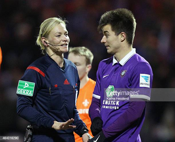 Referee Bibiana Steinhaus talks to Stefan Mugosa of Aue during the Second League match between FC Erzgebirge Aue and SV Darmstadt 98 at...