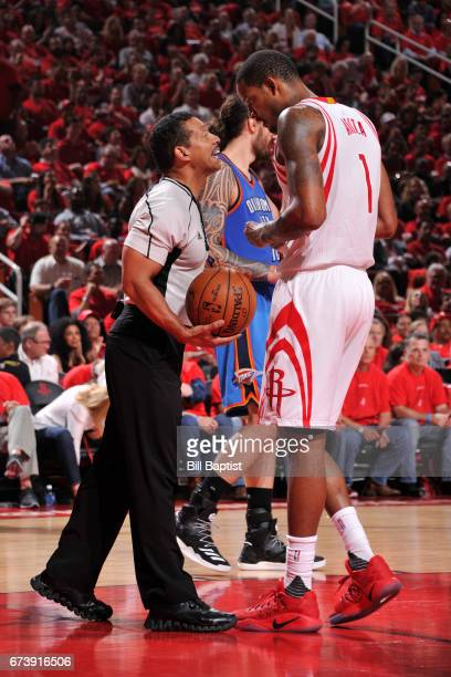 Referee Bill Kennedy talks to Trevor Ariza of the Houston Rockets during Game Five of the Western Conference Quarterfinals against the Oklahoma City...