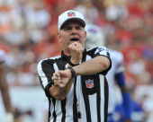 NFL referee Bill Vinovich calls a penalty as the Buffalo Bills play against the Tampa Bay Buccaneers December 8 2013 at Raymond James Stadium in...