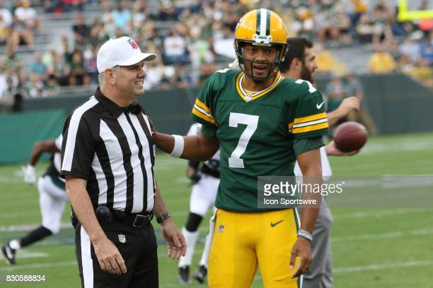 referee Bill Vinovich shares a laugh with Green Bay Packers quarterback Brett Hundley during a football game between the Green Bay Packers and the...