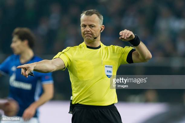 Referee Bjoern Kuipers gestures during the UEFA Europa League Round of 16 first leg match between FC Schalke 04 and Borussia Moenchengladbach at...