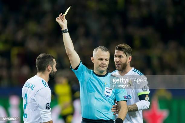 Referee Bjoern Kuipers show Daniel Carvajal of Real Madrid the yellow card during the UEFA Champions League group H match between Borussia Dortmund...