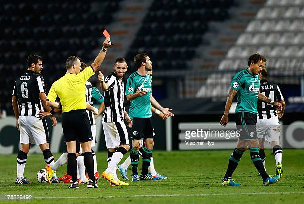 Referee Bjoern Kuipers shows a red card to Jermaine Jones of Schalke during the UEFA Champions League second leg playoff match between PAOK Saloniki...