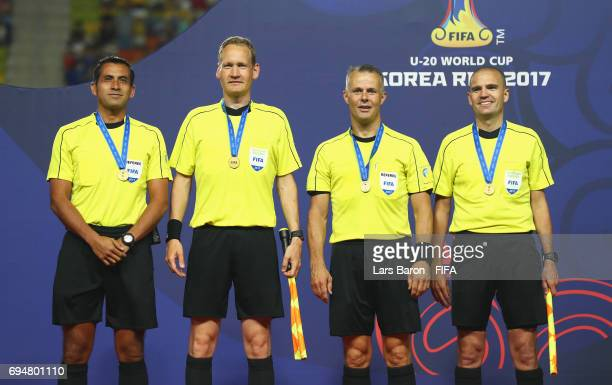 Referee Bjorn Kuipers and fellow officials pose after the FIFA U20 World Cup Korea Republic 2017 Final between Venezuela and England at Suwon World...