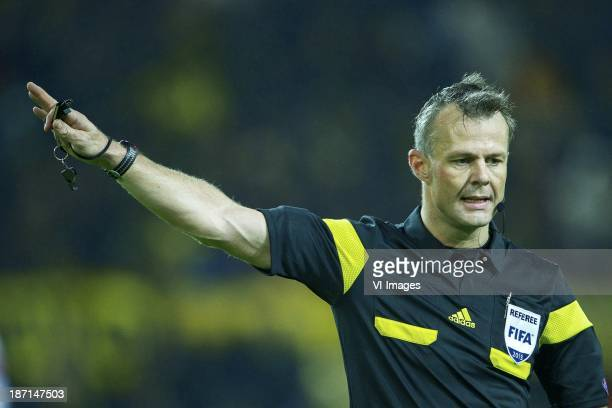 referee Bjorn Kuipers during the UEFA Champions League match between Borussia Dortmund and Arsenal FC on November 06 2013 at the Signal Iduna Park...