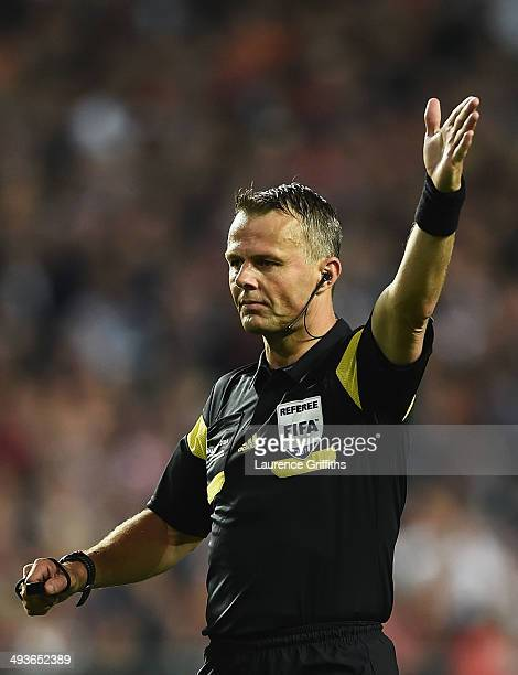 Referee Bjorn Kuipers in action during the UEFA Champions League Final between Real Madrid and Atletico de Madrid at Estadio da Luz on May 24 2014 in...