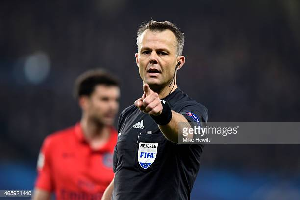 Referee Bjorn Kuipers of the Netherlands gives a decision during the UEFA Champions League Round of 16 second leg match between Chelsea and Paris...