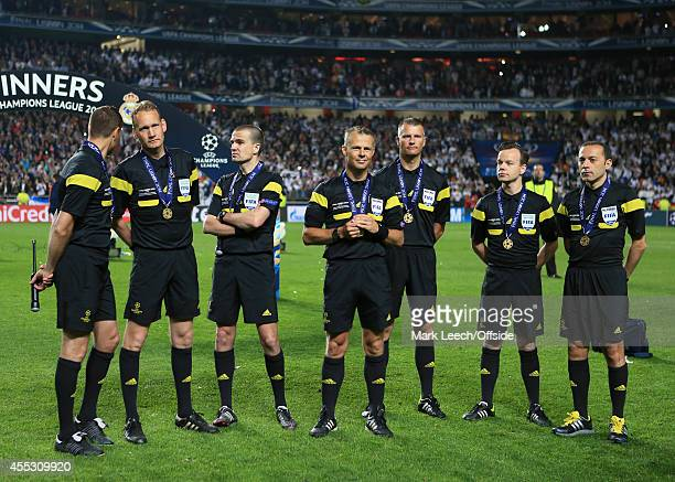 Referee Bjorn Kuipers stands with his assistants after collecting their medals following the UEFA Champions League Final between Real Madrid and...