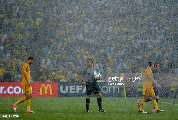 Referee Bjorn Kuipers suspends play due to bad weather during the UEFA EURO 2012 group D match between Ukraine and France at Donbass Arena on June 15...
