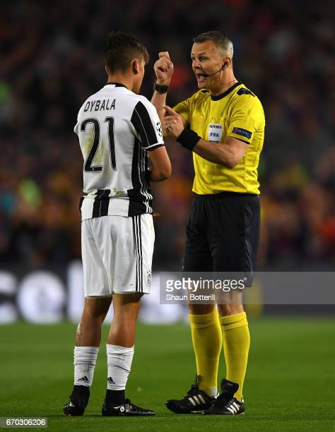 Referee Björn Kuipers speaks to Paulo Dybala of Juventus during the UEFA Champions League Quarter Final second leg match between FC Barcelona and...