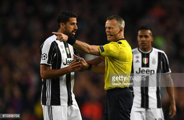 Referee Björn Kuipers speaks to Sami Khedira of Juventus during the UEFA Champions League Quarter Final second leg match between FC Barcelona and...