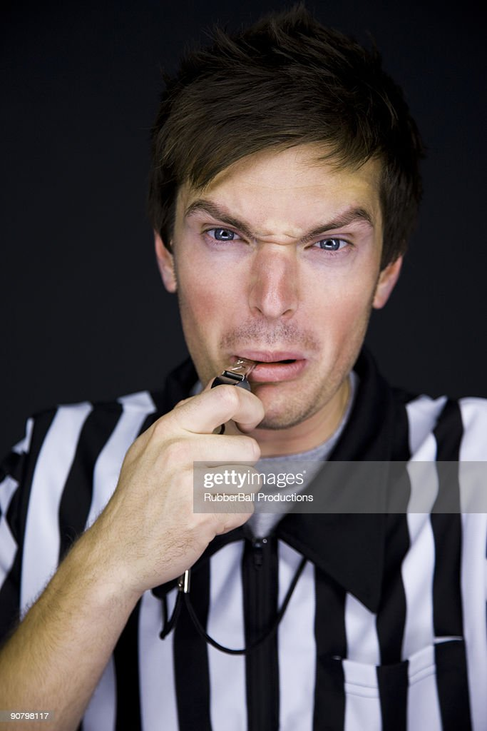 referee blowing his whistle : Stock Photo