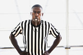 Referee blowing whistle