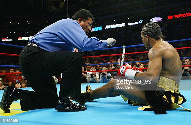 Referee Bobby Ferraro L counts down Sharmba Mitchell after Mitchell was knocked down for the second time in the fight against Kostya Tszyu of...