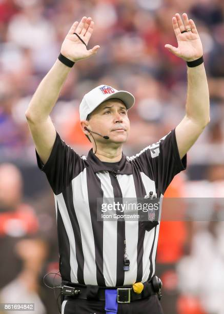 Referee Brad Allen gives the signal for the twominute warning during the football game between the Cleveland Browns and Houston Texans on October 15...