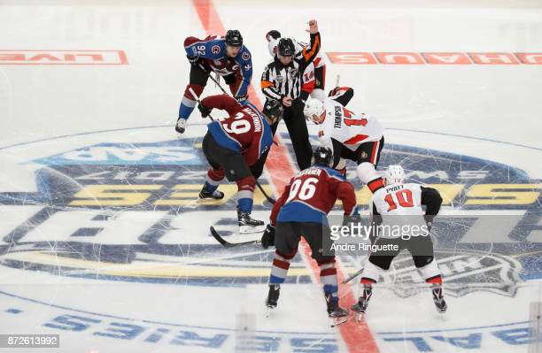 Referee Brian Pochmara drops the puck on the opening faceoff of the Global Series game with Nate Thompson Alexandre Burrows and Tom Pyatt of the...