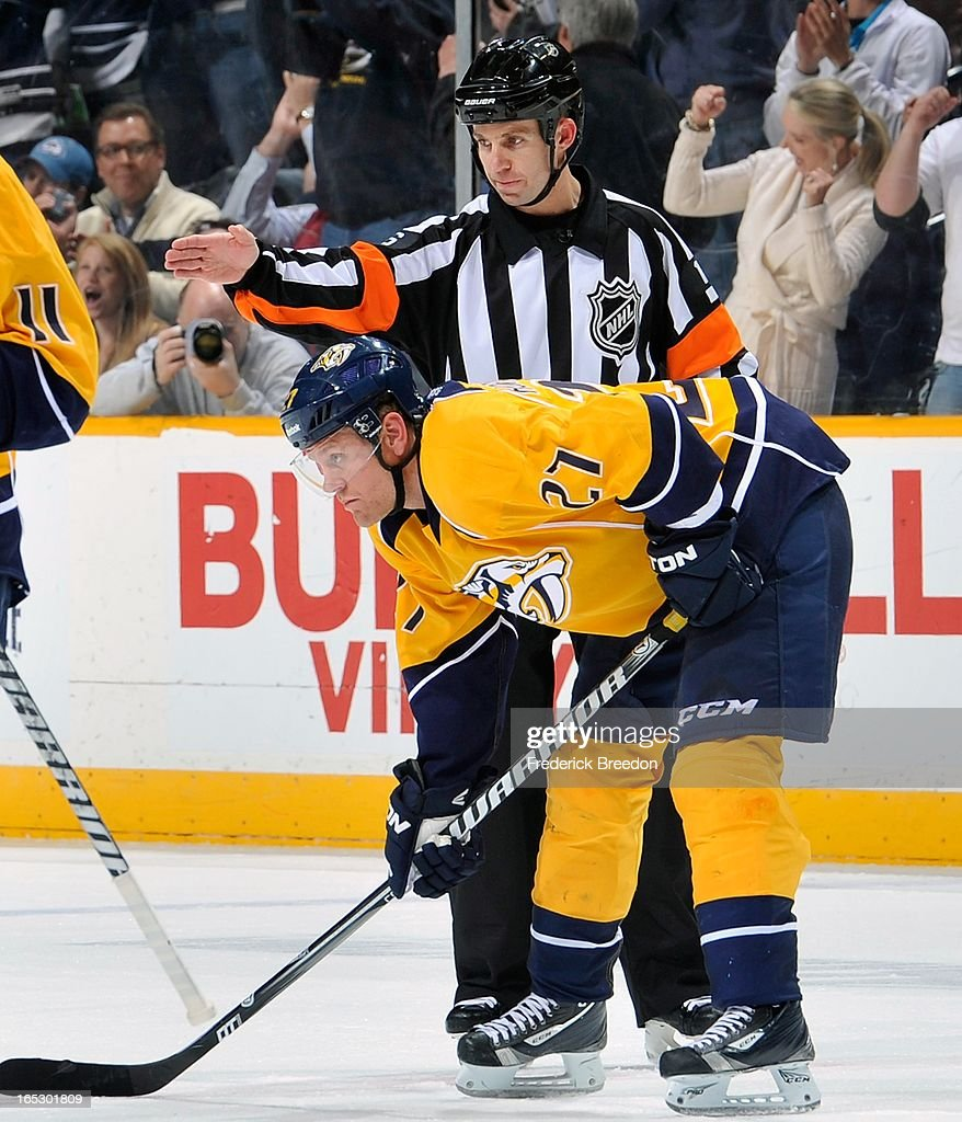 Referee Brian Pochmara #16 makes the signal to confirm a goal by <a gi-track='captionPersonalityLinkClicked' href=/galleries/search?phrase=Patric+Hornqvist&family=editorial&specificpeople=1966879 ng-click='$event.stopPropagation()'>Patric Hornqvist</a> #27 of the Nashville Predators against the Colorado Avalanche at the Bridgestone Arena on April 2, 2013 in Nashville, Tennessee.