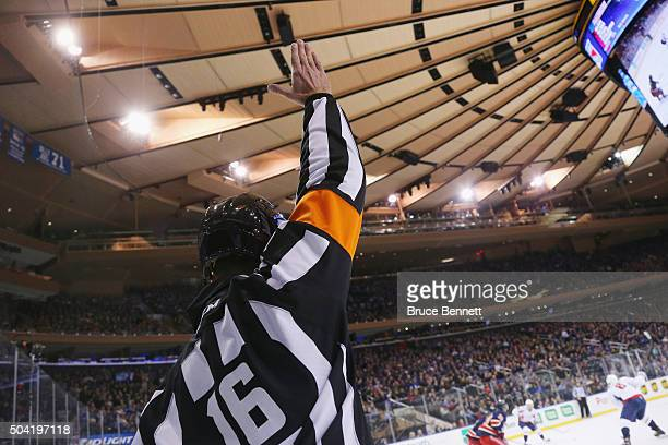 Referee Brian Pochmara signals a penalty during the game between the New York Rangers and the Washington Capitals at Madison Square Garden on January...