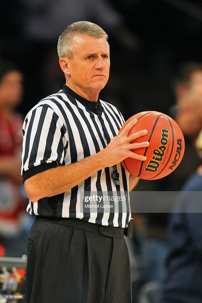 Referee Bryan Kersey looks on during the Jimmy V Classic college basketball game between the Connecticut Huskies the North Carolina State Wolfpack on December 4, 2012 at Madison Square Garden in New York, New York. The Wolfpack won 69-65.