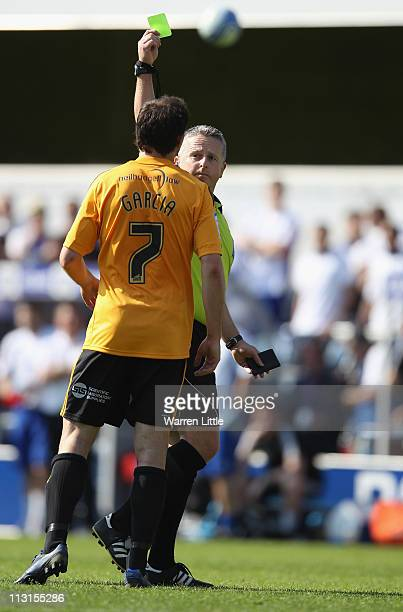 Referee C H Webster shows Richard Garcia of Hull City a yellow card during the npower Championship match between Queens Park Rangers and Hull City at...