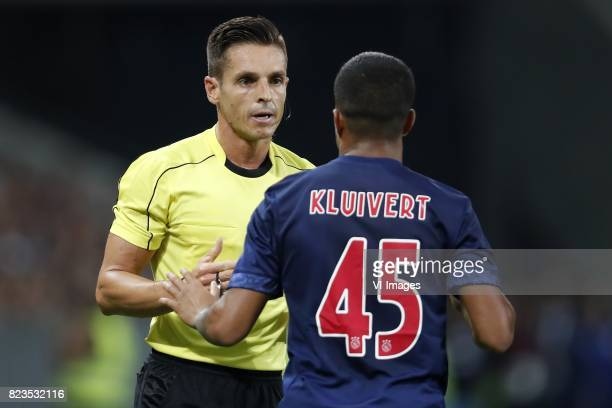 referee Carlos Del Cerro Justin Kluivert of Ajax during the UEFA Champions League third round qualifying first leg match between OGC Nice and Ajax...