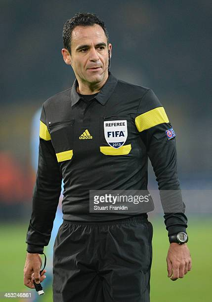 Referee Carlos Velasco Carballo looks on during the UEFA Champions League group F match between Borussia Dortmund and SSC Napoli at Signal Iduna Park...