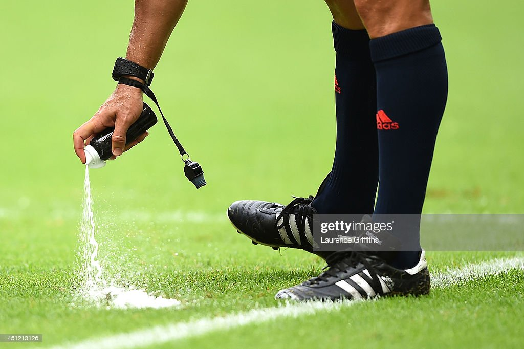 Referee Carlos Velasco Carballo sprays a temporary line during the 2014 FIFA World Cup Brazil Group F match between Bosnia and Herzegovina and Iran...