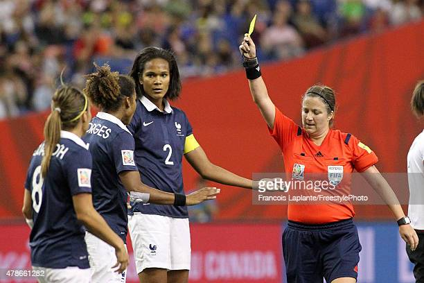 Referee Carol Anne Chenard signals a yellow card to Laura Georges of France during the FIFA Women's World Cup Canada 2015 quarter final match between...