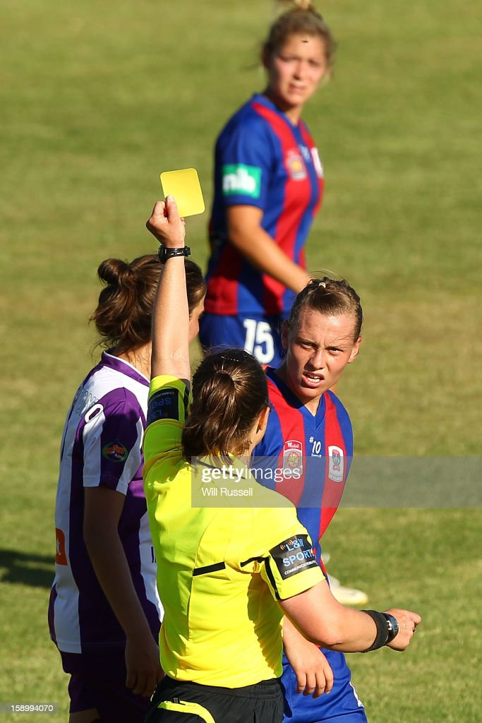Referee Catherine Hoffman shows the yellow card to <a gi-track='captionPersonalityLinkClicked' href=/galleries/search?phrase=Emily+Van+Egmond&family=editorial&specificpeople=4667782 ng-click='$event.stopPropagation()'>Emily Van Egmond</a> of the Jets during the round 11 W-League match between the Perth Glory and the Newcastle Jets at Intiga Stadium on January 5, 2013 in Perth, Australia.
