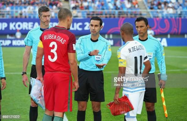 Referee Cesar Ramos spins the coin with Ruben Dias of Portugal and Nicolas de la Cruz of Uruguay prior to the FIFA U20 World Cup Korea Republic 2017...