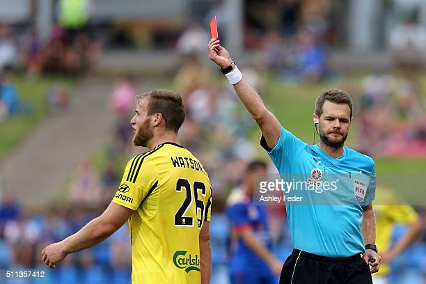 Referee Chris Beath issues a red card to Hamish Watson of the Phoenix during the round 20 ALeague match between the Newcastle Jets and Wellington...
