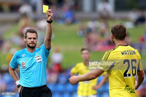 Referee Chris Beath issues a second yellow card to Hamish Watson of the Phoenix during the round 20 ALeague match between the Newcastle Jets and...
