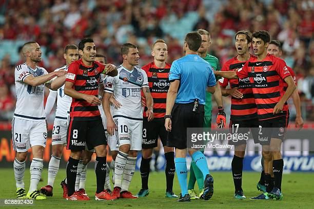 Referee Chris Beath talks to the players during the round 10 ALeague match between the Western Sydney Wanderers and the Melbourne Victory at ANZ...
