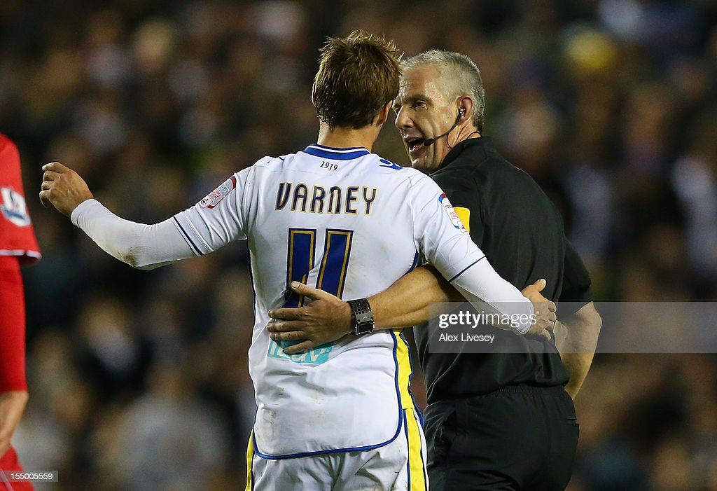 Referee <a gi-track='captionPersonalityLinkClicked' href=/galleries/search?phrase=Chris+Foy+-+Referee&family=editorial&specificpeople=696483 ng-click='$event.stopPropagation()'>Chris Foy</a> and Luke Varney of Leeds United react during the Capital One Cup Fourth Round match between Leeds United and Southampton at Elland Road on October 30, 2012 in Leeds, England.