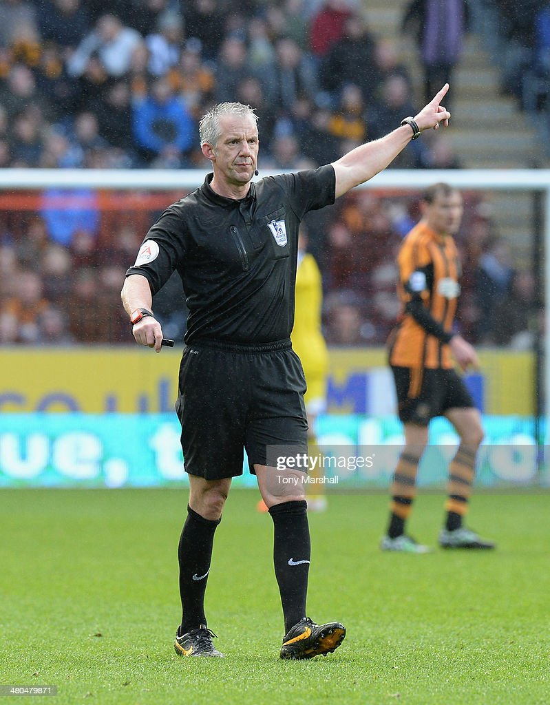 Referee Chris Foy during the Barclays Premier League match between Hull City and West Bromwich Albion at KC Stadium on March 22, 2014 in Hull, England.