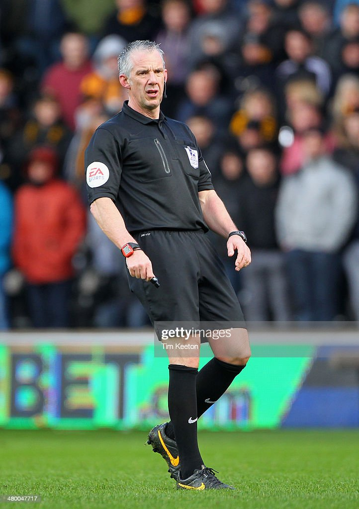 Referee <a gi-track='captionPersonalityLinkClicked' href=/galleries/search?phrase=Chris+Foy+-+Referee&family=editorial&specificpeople=696483 ng-click='$event.stopPropagation()'>Chris Foy</a> in action during the Barclays Premier League match between Hull City and West Bromwich Albion at the KC Stadium on March 22, 2014 in Hull, England.