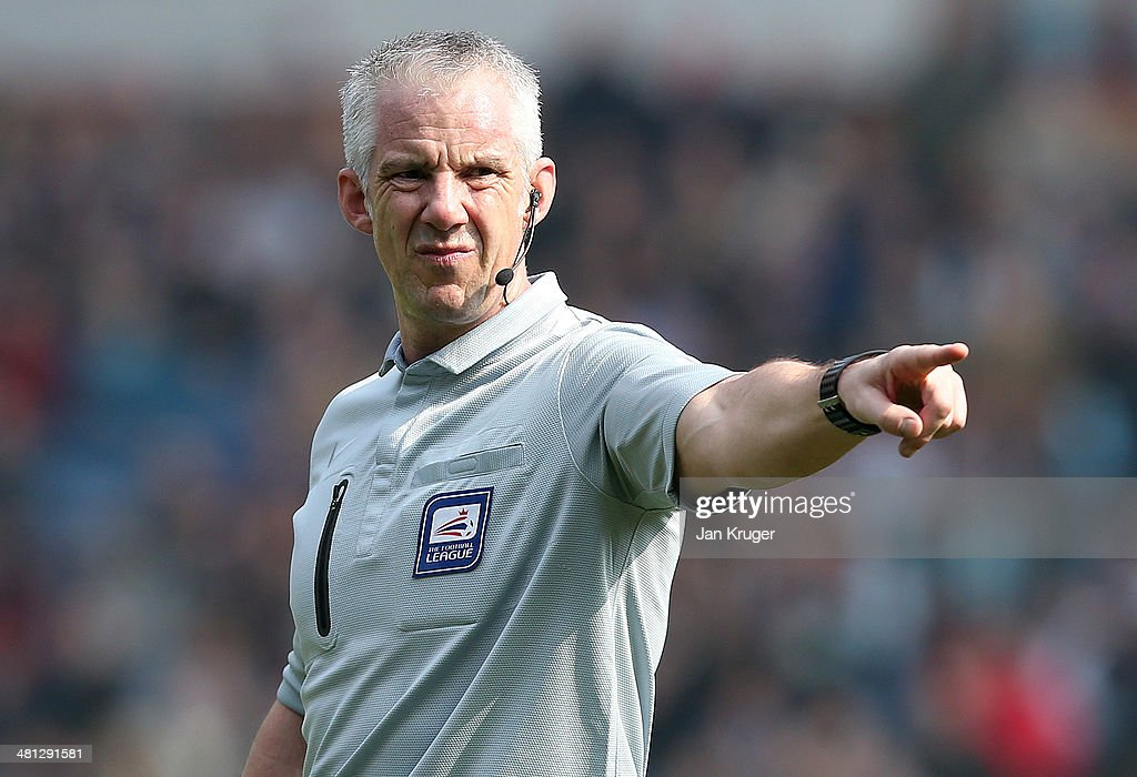 Referee Chris Foy in action during the Sky Bet Championship match between Burnley and Leicester City at Turf Moor on March 29, 2014 in Burnley, England.