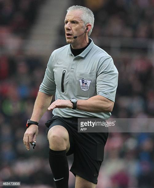 Referee Chris Foy officiates during the English Premier League football match between Sunderland and Southampton at the Stadium of Light in...