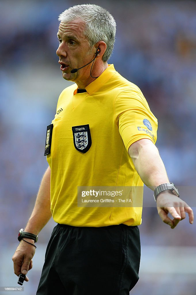 Referee <a gi-track='captionPersonalityLinkClicked' href=/galleries/search?phrase=Chris+Foy+-+Referee&family=editorial&specificpeople=696483 ng-click='$event.stopPropagation()'>Chris Foy</a> reacts during the FA Cup with Budweiser Semi Final match between Chelsea and Manchester City at Wembley Stadium on April 14, 2013 in London, England.