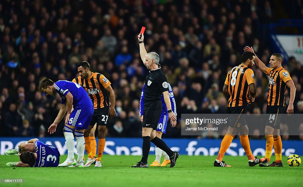 Referee <a gi-track='captionPersonalityLinkClicked' href=/galleries/search?phrase=Chris+Foy+-+Referee&family=editorial&specificpeople=696483 ng-click='$event.stopPropagation()'>Chris Foy</a> shows a red card to <a gi-track='captionPersonalityLinkClicked' href=/galleries/search?phrase=Tom+Huddlestone&family=editorial&specificpeople=735077 ng-click='$event.stopPropagation()'>Tom Huddlestone</a> of Hull City (8) after a challenge on <a gi-track='captionPersonalityLinkClicked' href=/galleries/search?phrase=Filipe+Luis&family=editorial&specificpeople=3941966 ng-click='$event.stopPropagation()'>Filipe Luis</a> of Chelsea (3) during the Barclays Premier League match between Chelsea and Hull City at Stamford Bridge on December 13, 2014 in London, England.