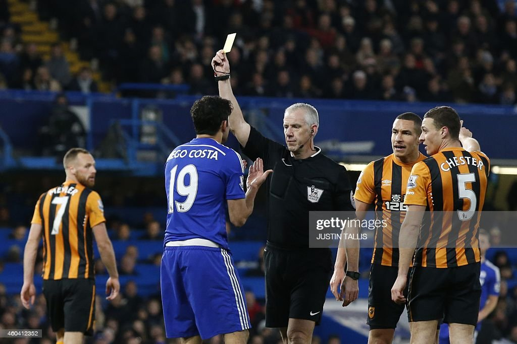 Referee Chris Foy shows Chelsea's Brazilianborn Spanish striker Diego Costa a yellow card for simulation during the English Premier League football...