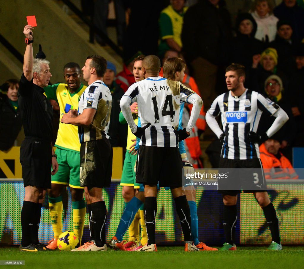 Referee <a gi-track='captionPersonalityLinkClicked' href=/galleries/search?phrase=Chris+Foy+-+Referee&family=editorial&specificpeople=696483 ng-click='$event.stopPropagation()'>Chris Foy</a> shows Loic Remy of Newcastle United a red card during the Barclays Premier League match between Norwich City and Newcastle United at Carrow Road on January 28, 2014 in Norwich, England.