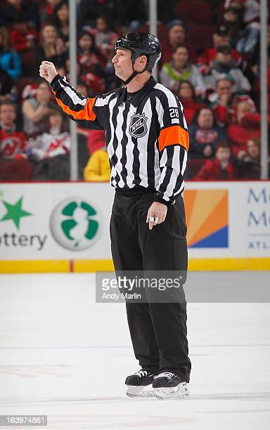 Referee Chris Lee calls a roughing penalty during the game between the Montreal Canadiens and the New Jersey Devils at the Prudential Center on March...