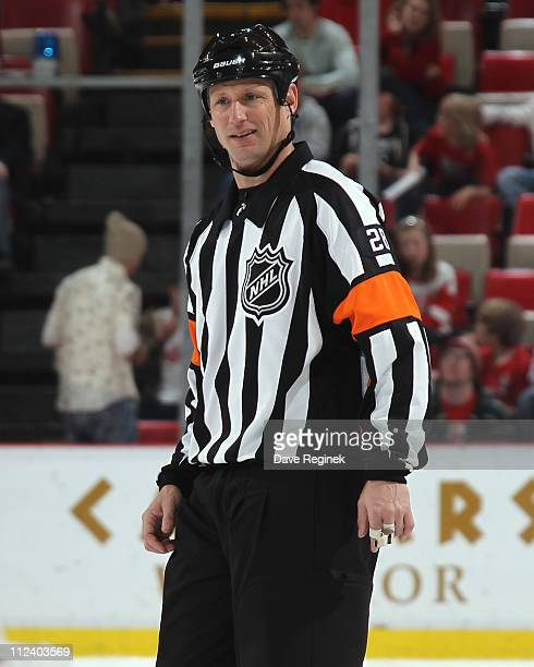 Referee Chris Lee follows the game action during an NHL game between the Chicago Blackhawks and the Detroit Red Wings at Joe Louis Arena on April 8...