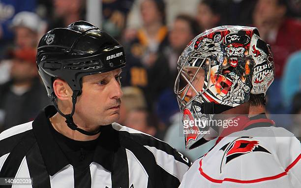 Referee Chris Lee has a conversation with goaltender Cam Ward of the Carolina Hurricanes during their game with Buffalo Sabres at First Niagara...