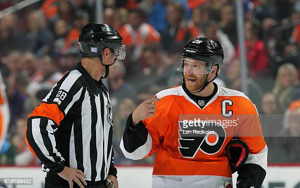Referee Chris Lee has a discussion with Claude Giroux of the Philadelphia Flyers in the third period against the Buffalo Sabres on October 25 2016 at...