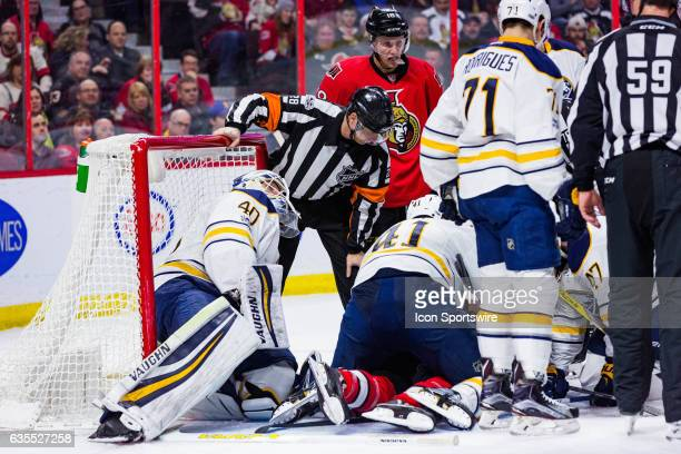 Referee Chris Lee looks for the puck during second period National Hockey League action between the Buffalo Sabres and Ottawa Senators on February 14...