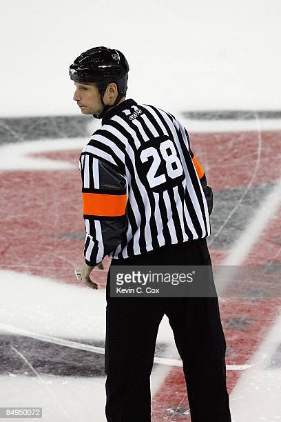 Referee Chris Lee looks on during the Carolina Hurricanes game against the Boston Bruins on February 17 2009 at RBC Center in Raleigh North Carolina