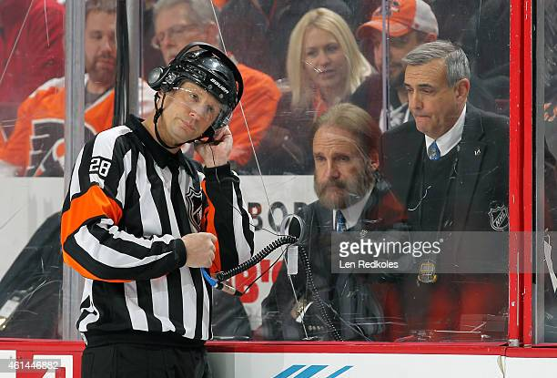 Referee Chris Lee reviews a disputed third period goal by Karl Alzner of the Washington Capitals against the Philadelphia Flyers on January 8 2015 at...