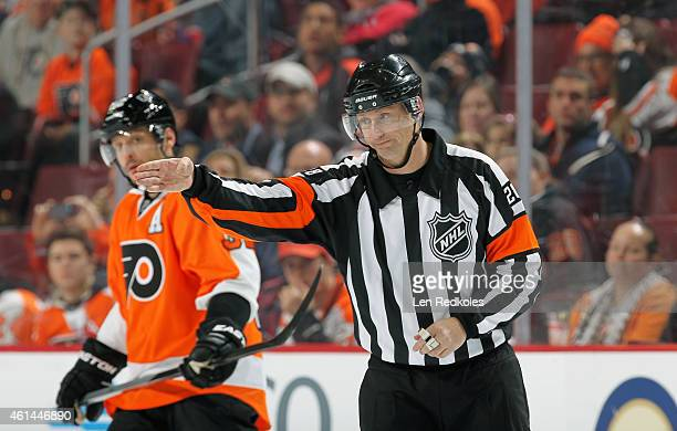 Referee Chris Lee signals a good goal during a game between the Philadelphia Flyers and the Washington Capitals on January 8 2015 at the Wells Fargo...